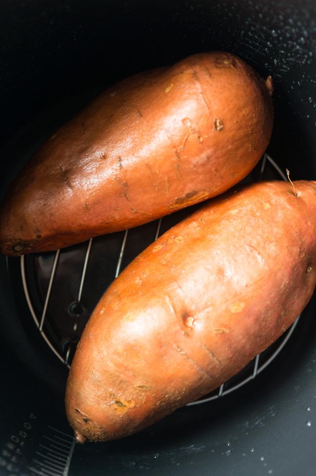 Spinach Artichoke Sweet Potato Skins. A healthy version of sweet potato skins with greek yogurt, turkey bacon, and green onions.