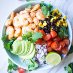 Garlic Lime Shrimp & Quinoa Salad. A zesty, nutrient dense salad that will wow your guests with its amazing fresh flavors!