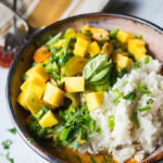 Summertime Pressure Cooker Mango Chicken Curry with Coconut Rice. A healthy and satisfying curry with summer fruits and vegetables on a bed of rich coconut rice.