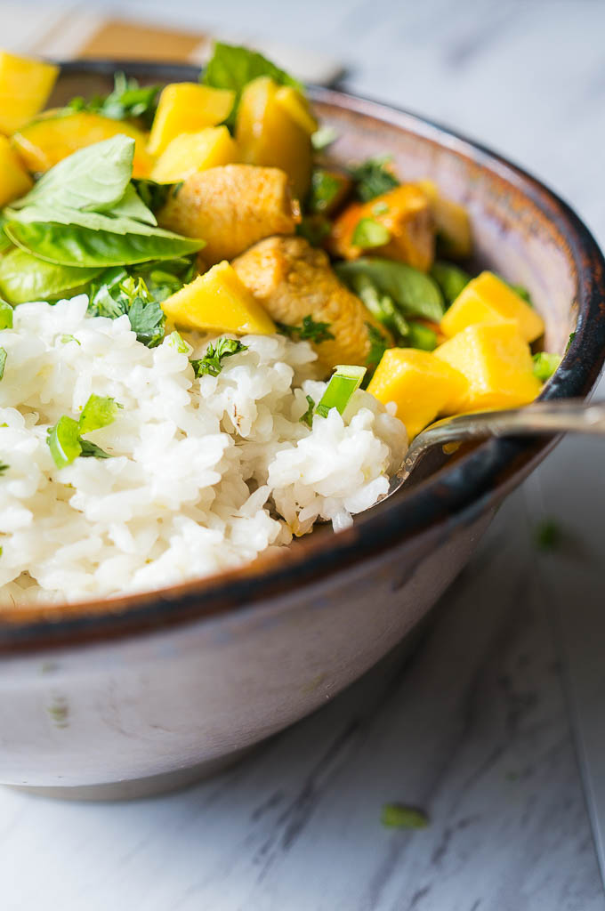 ... curry with summer fruits and vegetables on a bed of rich coconut rice