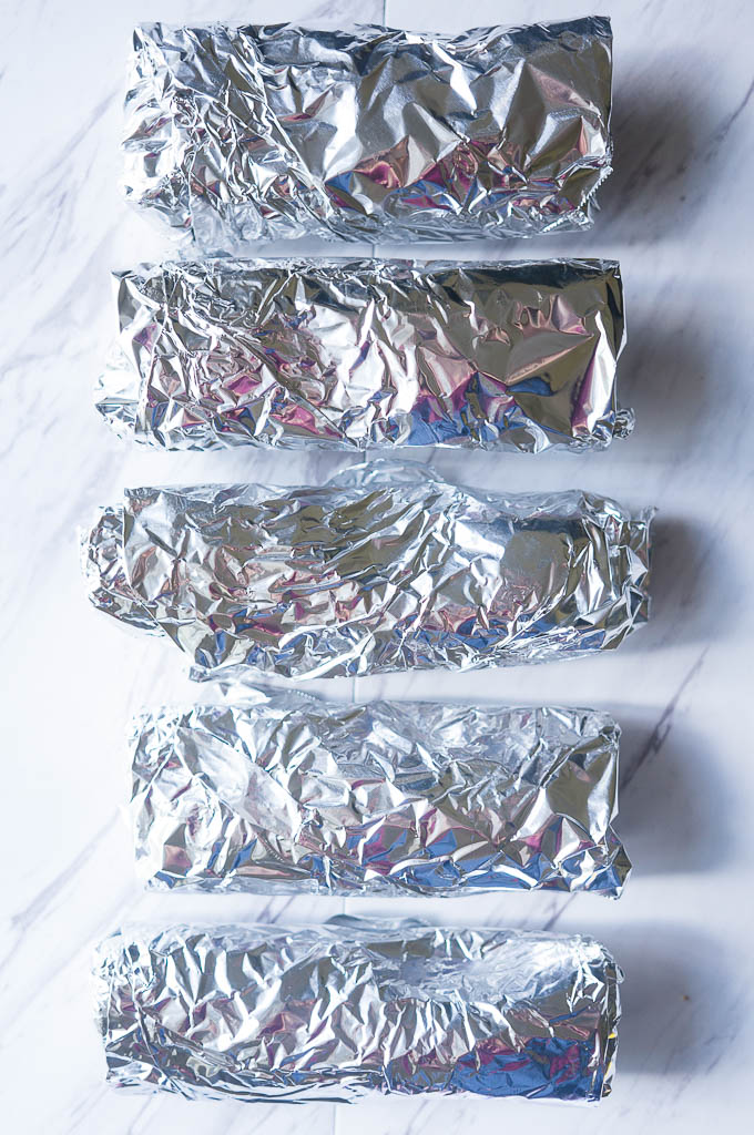 Freezer Breakfast Burritos. A great solution to morning craziness! Make a batch of these at the beginning of the week and have hearty, healthy breakfasts ready to go!