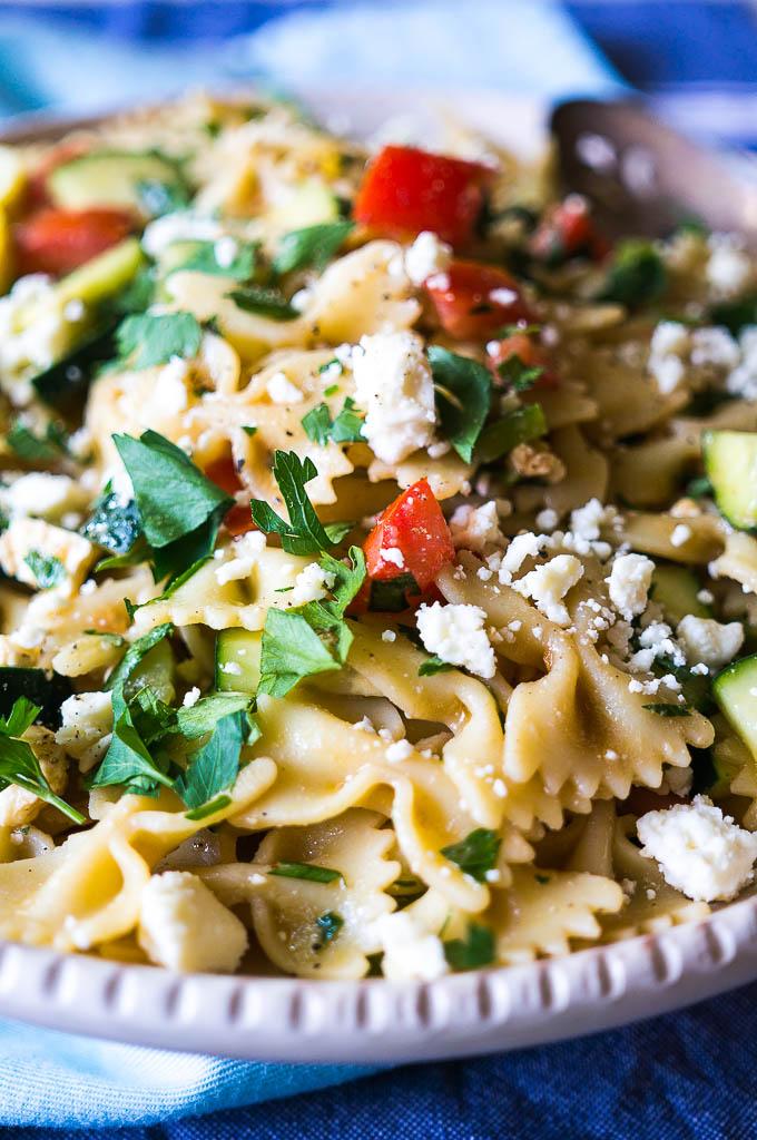 Colorful pasta salad on a blue napkin.
