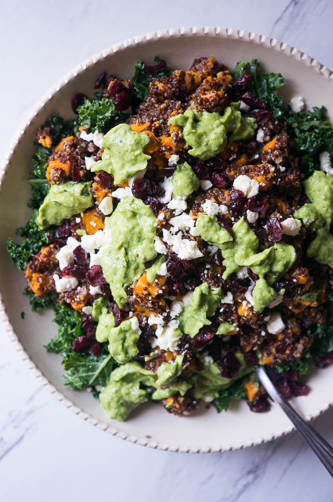 Pressure Cooker Kale & Quinoa Salad with Zingy Avocado Sauce. A beautiful flavor filled salad infused with lime, dried fruit, and creamy avocado sauce.