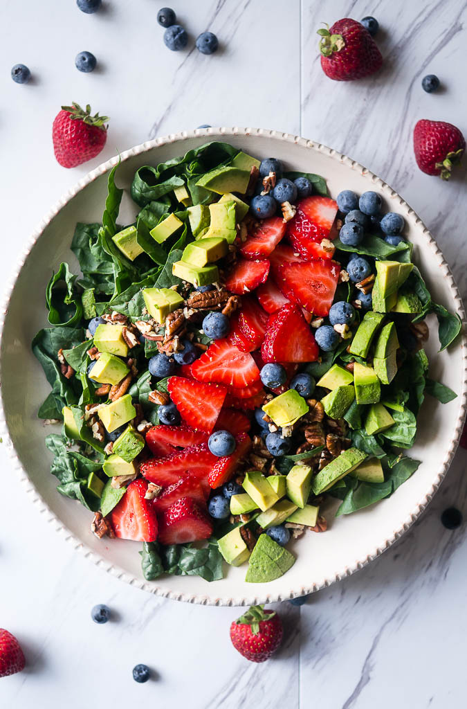 Summer Spinach and Berry Salad with Lemon Chia Vinaigrette. A refreshing summer salad with the bright flavors of fresh berries, lemon zest, cool avocado, and dark leafy greens.