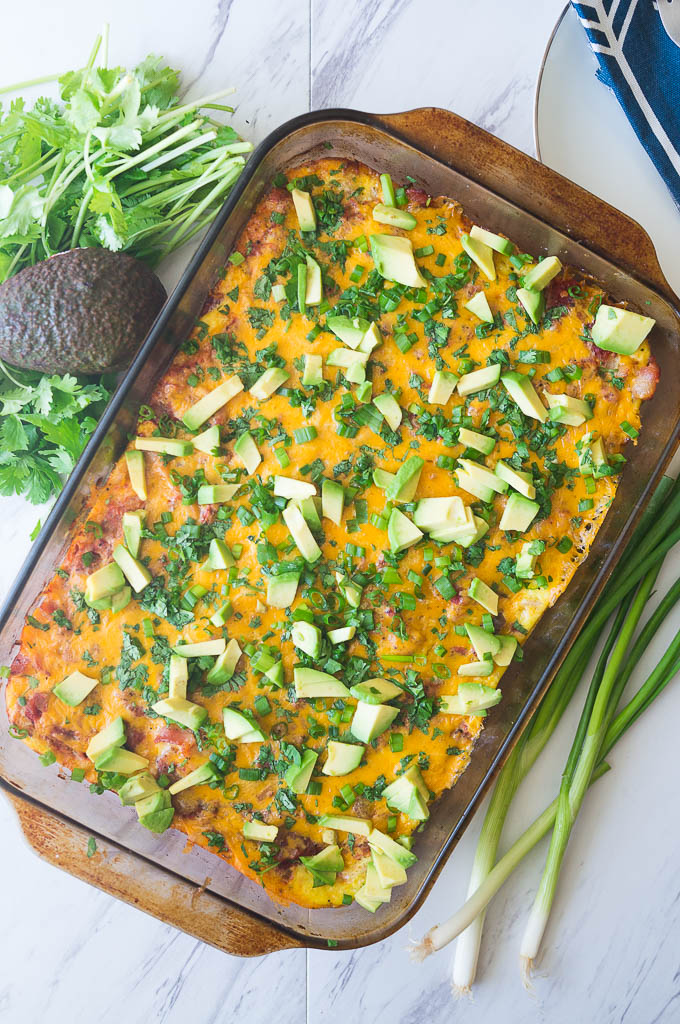 Migas Casserole is a twist on a traditional breakfast egg bake. Tortilla chips create the base and then it gets layered with bacon, salsa, eggs, and other goodies!