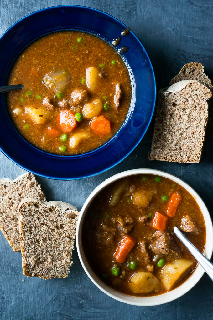 Pressure Cooker Hearty Beef Stew. A rich and hearty stick to your ribs kind of stew full of carrots, potatoes, green peas, and savory herbs.