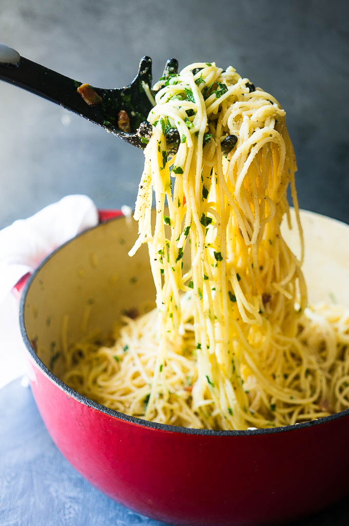 Spaghetti Alla Carbonara. Infused with bits of crispy bacon, rich olive oil, and nutty parmesan cheese, this go-to carbonara recipe is a dinner favorite for even the pickiest eaters!