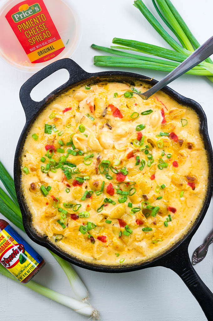 Pimiento Mac and Cheese is ultra creamy with bacon bits, crisp green onion, and a light dash of hot sauce for an added little kick.