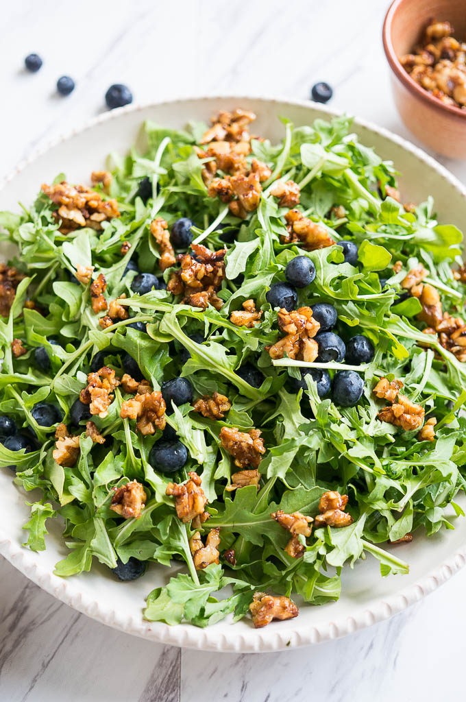 Blueberry, Arugula, and Toasted Walnut Salad is drizzled with a balsamic orange dressing and is the winner in the most refreshing summer salad category!
