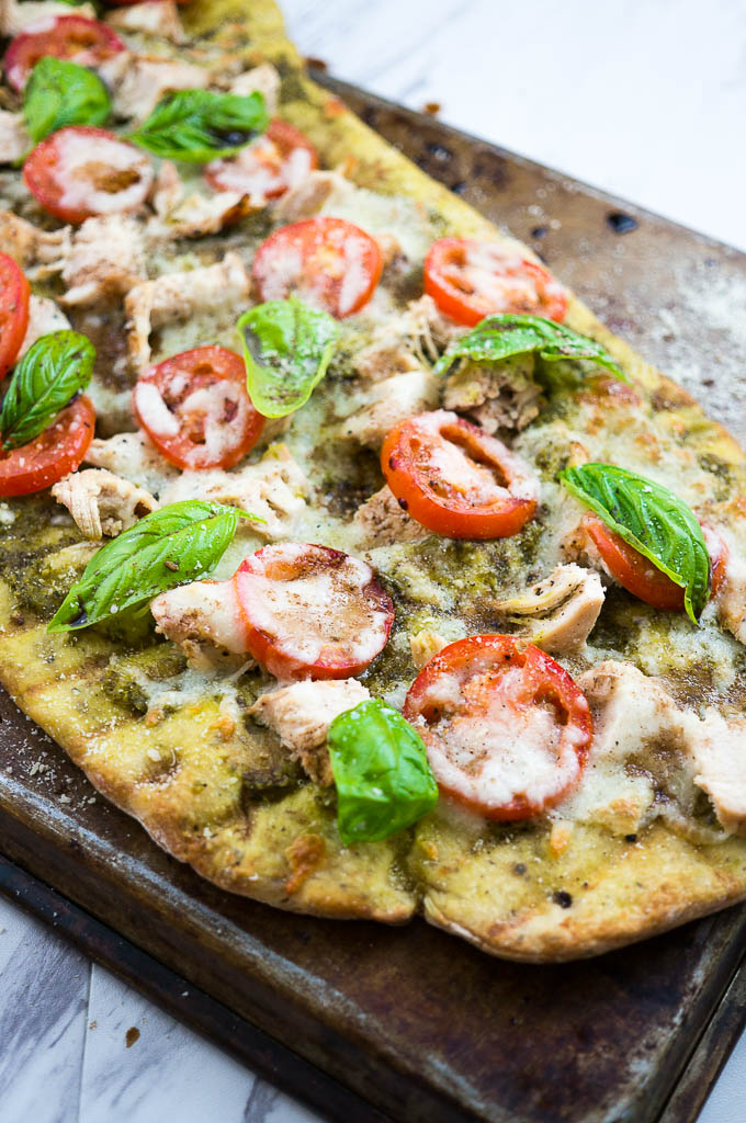 Caprese and Pesto Grilled Chicken Pizza is a fresh summer favorite guaranteed to be polished off in one sitting!