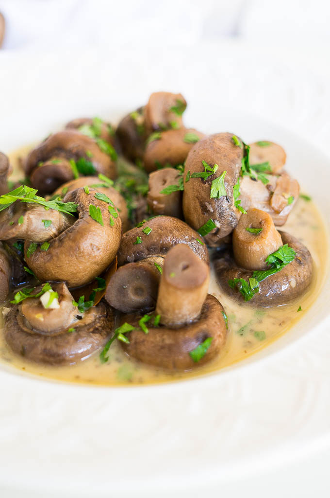 Pressure Cooker Garlic Herb Mushrooms are an easy and satisfying side dish that can be enjoyed alone or mixed into pasta, sliced and put on sandwiches, or any number of other possibilities!