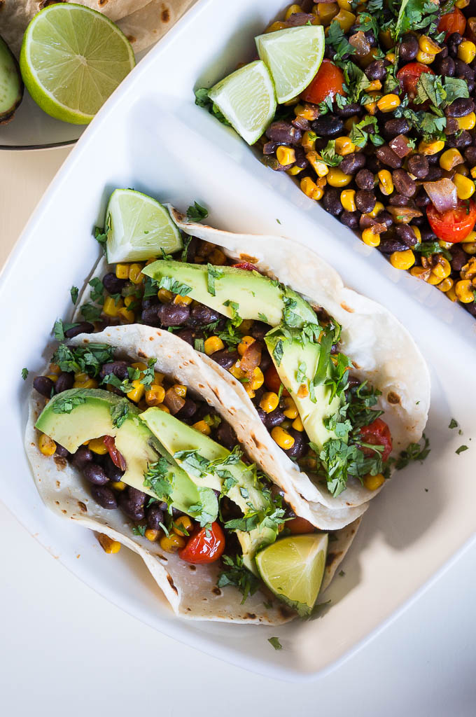Corn, Black Bean, and Avocado Tacos - we're going meatless but still totally satisfying with these veggie loaded tacos!