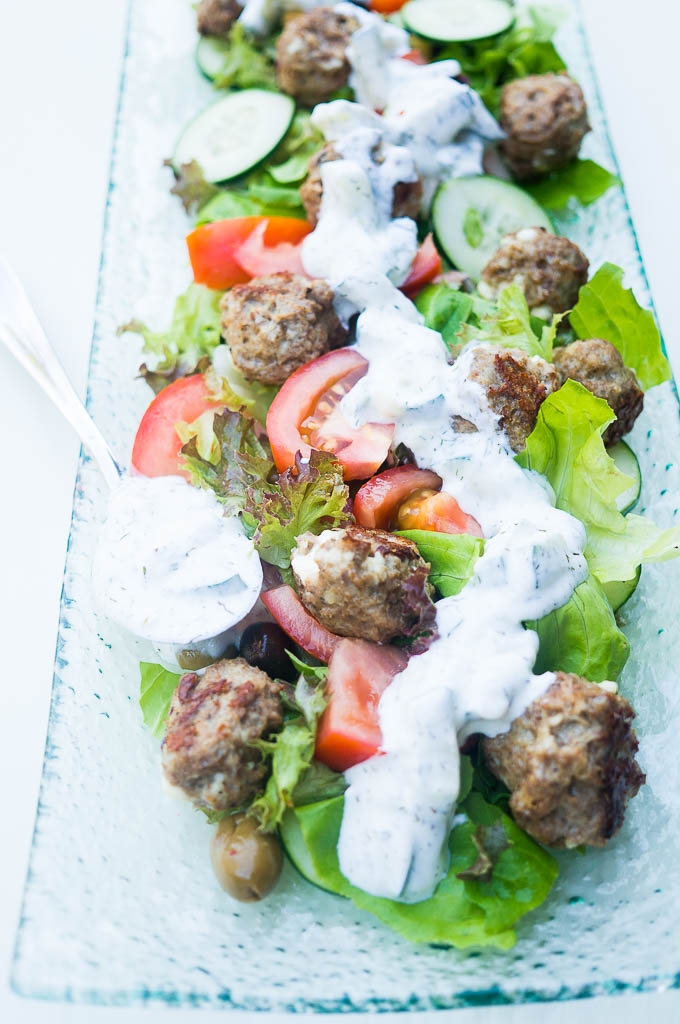 Impress your guests with these fancy pants Pressure Cooker Greek Lamb Meatballs with Salad and Tzatziki. The secret? It's 10X easier than it looks!!