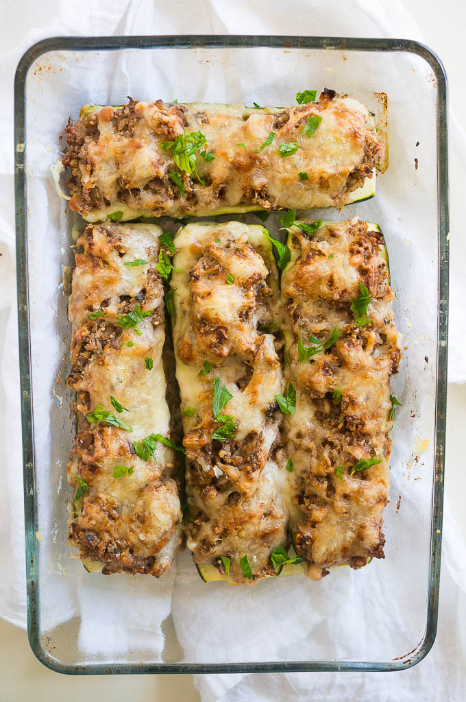 Zuccanoes (stuffed zucchini) are an ultra filling vegetarian dinner with almonds, rice, savory veggies, and fresh herbs!