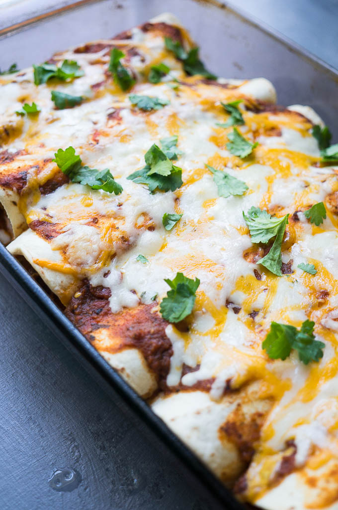 Harvest Veggie and Cheese Enchiladas - full of roasted fall veggies and classic mexican spice! You won't even miss the meat in this one!