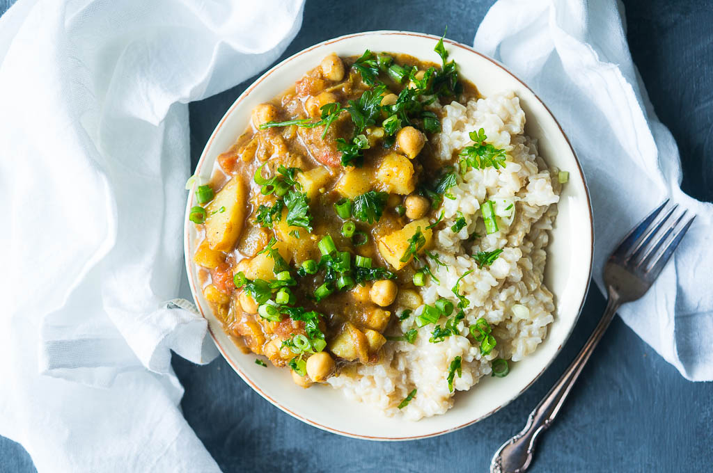 Pressure Cooker Chickpea and Potato Curry is a perfectly spiced meatless dinner that is made in under 30 minutes and can be served on a heaping pile of comforting and healthy brown or white rice.