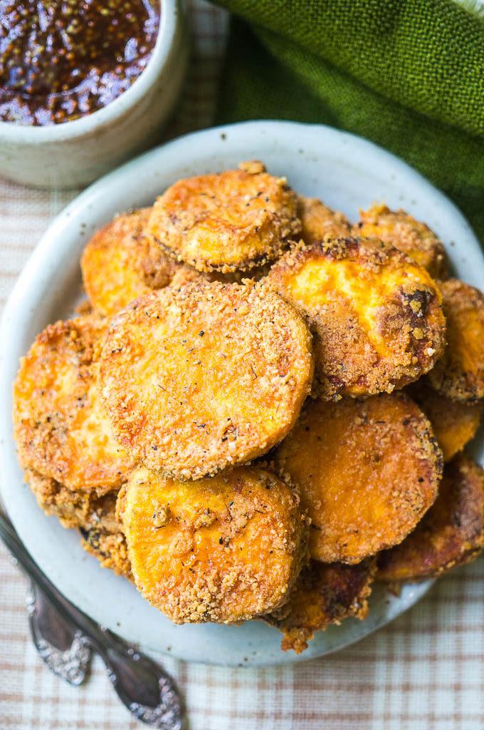 Crispy Parmesan Sweet Potato Rounds on a white plate with bbq dijon sauce.