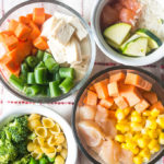 4 homemade baby food meals on a white napkin