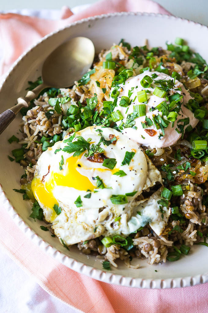 Rice, lentils, and a fried egg with parsley and cilantro.